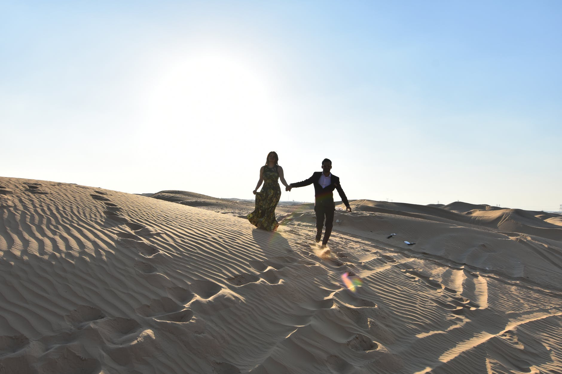 woman and man standing on the desert